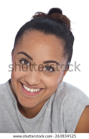 Close up Happy Face of an Asian Indian Girl with Tied Hairstyle Looking at Camera, Isolated on White Background.