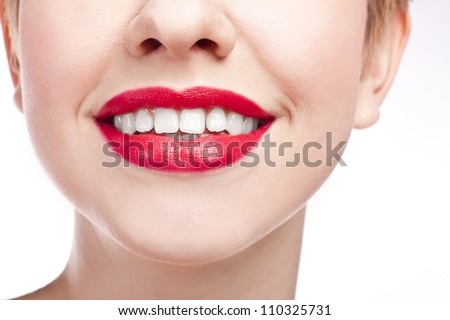 Close-up happy female smile with healthy white teeth, Cosmetology, dentistry and beauty care. Macro of woman's smiling mouth