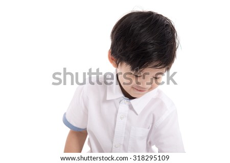 Close up happy little asian boy look down on white background isolated