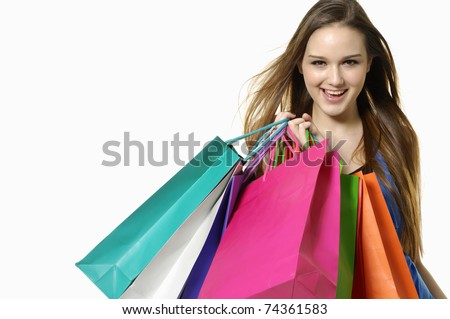 Close up happy shopping girl holding bags - stock photo