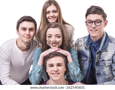 Close-up. Happy smiling young group looking at camera. isolated on white background. - stock photo
