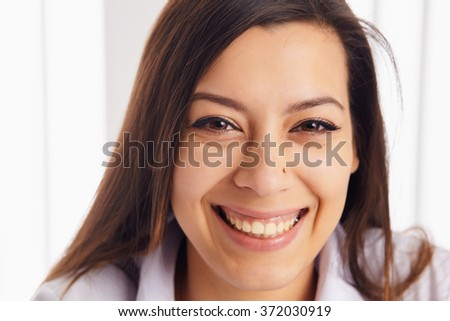 Close up Happy Young Woman, Showing Toothy Smile at the Camera - stock photo