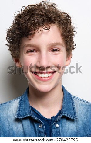 Close up head portrait of a young boy smiling  - stock photo