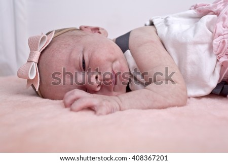 Close up head shot of a newborn baby girl - stock photo