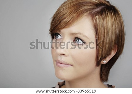 close up head shot of a young good looking woman