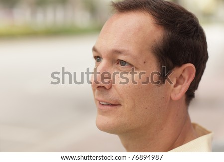 Close-up headshot of a handsome man - stock photo