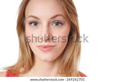 close-up headshot portrait of a neutral but friendly looking young woman - stock photo