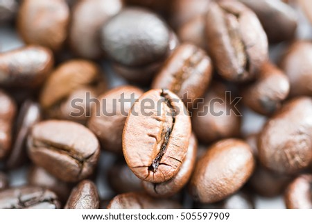 Close up heap of roasted brown coffee beans. coffee beans background