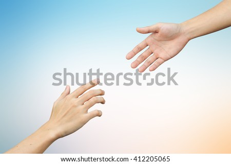 close up helping praying hand on blurred colorful sunny sky background:support aid love trust concept.healthcare therapy healing conceptual ideal.kindness compassion affection:friends and family. - stock photo