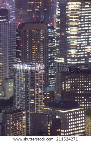 Close - up Hi building in Tokyo city at night   - stock photo
