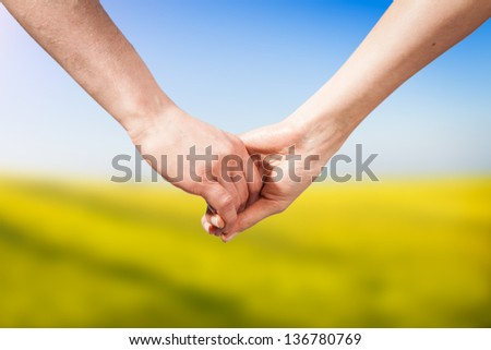Close-up Holding Hands - stock photo