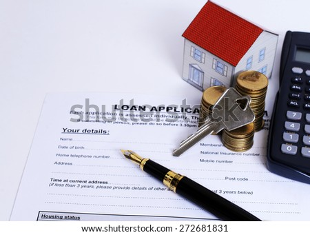 Close up home key on coins stack and paper house and calculator and fountain pen on Loan application form document