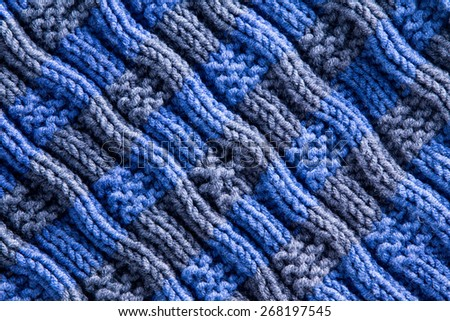 Close up Homemade Woven Crochet in Blue and Gray Colors with Diagonal Ridge Lines. Can be Used for Background Designs. - stock photo