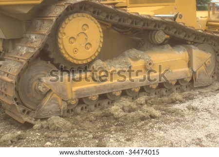 close-up horizontal of bulldozer tracks - stock photo