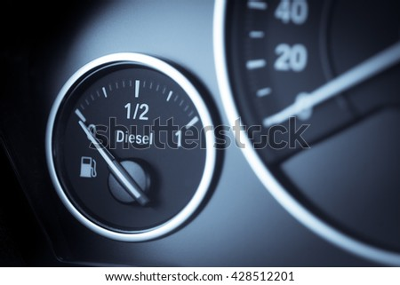 Close-up horizontal shot of a diesel fuel gauge in a car. - stock photo