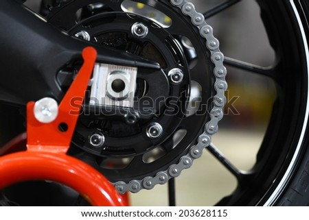 Close-up horizontal shot of a motorcycle chain.  - stock photo