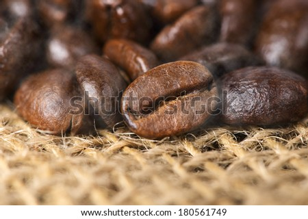 close up hot black roasted arabica coffee beans with smoke effect - stock photo