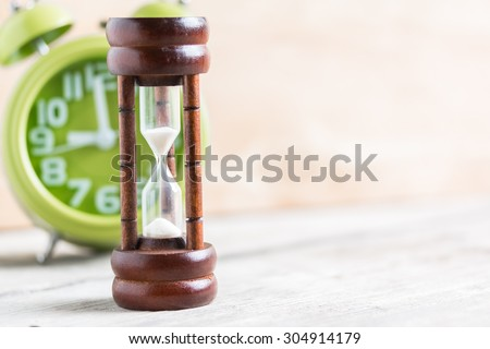 Close-up Hourglass on wood background