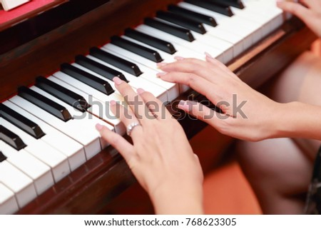 Close up human hands playing piano in Christmas party