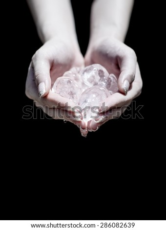 close up Ice cold on hands. Woman hands holding ice