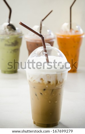 Close up iced coffee in plastic cup - stock photo
