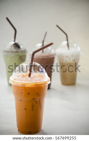 Close up iced thai tea  in plastic cup - stock photo