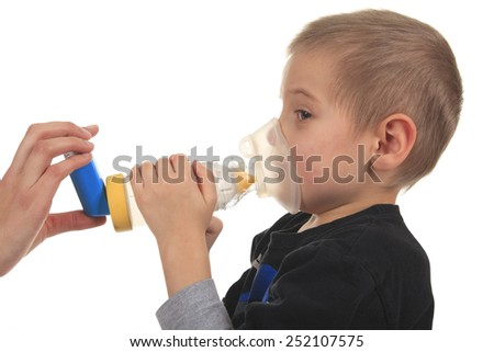 Close-up image little boy using inhaler for asthma. - stock photo