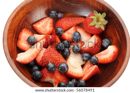 Close-up image of a bowl full of strawberries and blueberries