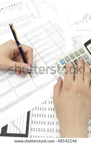 Close-up image of a businessman's hands calculating profit and analyzing stock charts - stock photo