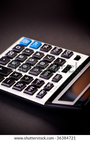 Close-up image of a calculator on a black background - stock photo