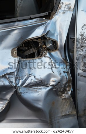 Close-up image of a car door handle was demolished from a collision accident with another vehicle.