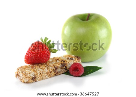 Close-up image of a cereal bar and fruits isolated on white background - stock photo