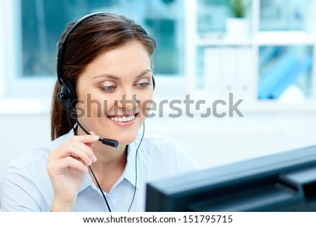 Close-up image of a cheerful representative wearing a headset - stock photo