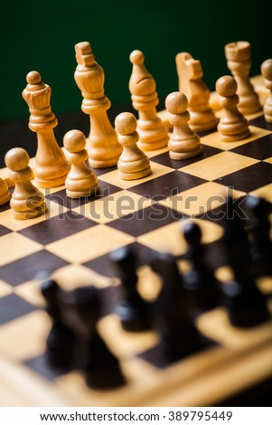 Close-up image of a chess board with chess pieces. - stock photo