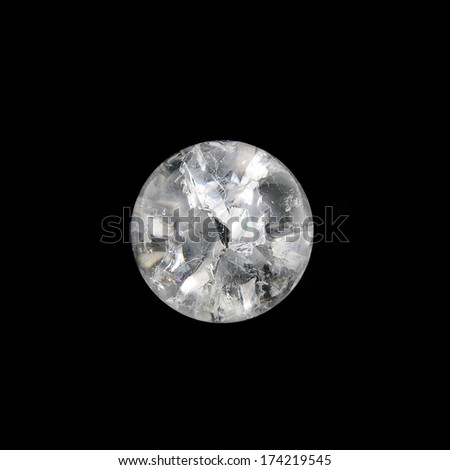 Close-up image of a Crystal clear glass marble against the black - stock photo