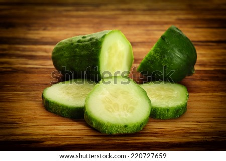 Close-up image of a cucumber slices on wooden background - stock photo