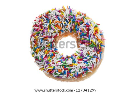 Close-up image of a donut with candy sprinkles - stock photo