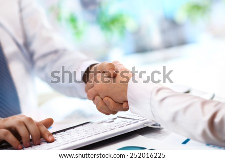 Close-up image of a firm handshake standing for a trusted partnership - stock photo