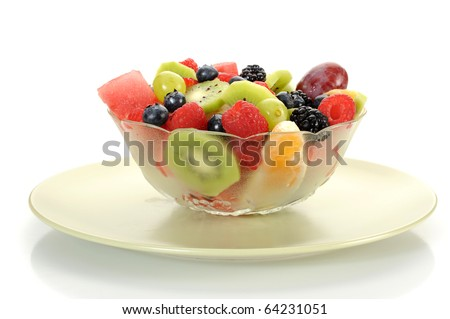 Close-up image of a fruit salad studio isolated on white background - stock photo