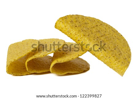 Close-up image of a group of crunchy taco shells isolated on white background