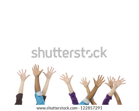 Close-up image of a group of hands gesturing at high five over the white surface - stock photo