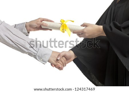 Close-up image of a hand of student receiving a graduation certificate - stock photo