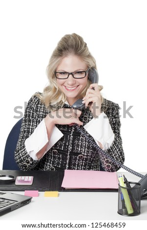 Close-up image of a happy female secretary answering phone calls on her office table - stock photo