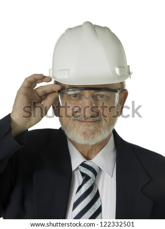 Close-up image of a happy old architect wearing hard - stock photo
