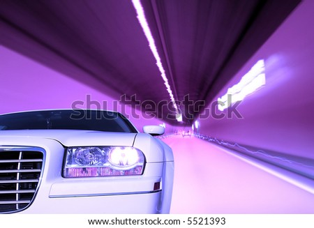 Close-up image of a luxury car in a tunnel - stock photo