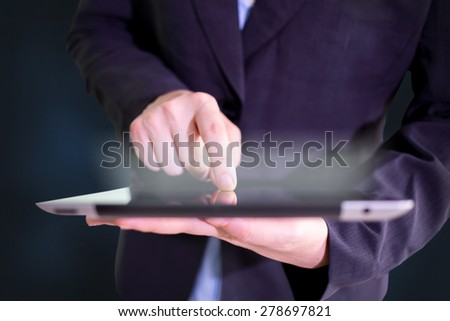 Close up image of a man using a tablet pc. - stock photo