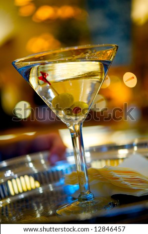 Close up image of a martini on a serving tray