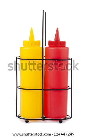 Close-up image of a mustard and catsup bottle isolated on the white background - stock photo