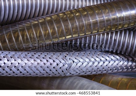 close up image of a number of reinforced vacuum hoses
