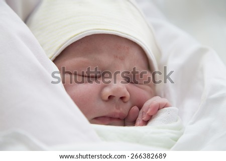 Close-up image of a one day old baby boy - stock photo
